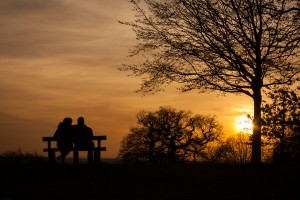 slough funerals | A couple enjoy watching the sun set.